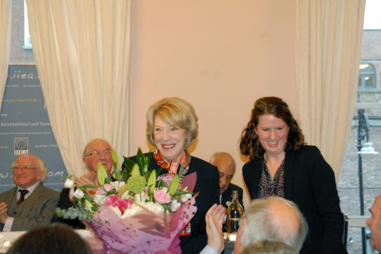 The First Lady, Sabina Higgins, receives a bouquet from Senior Researcher Linda Barry.