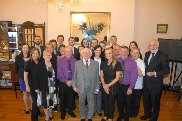 President Michael D Higgins with Staff Members.