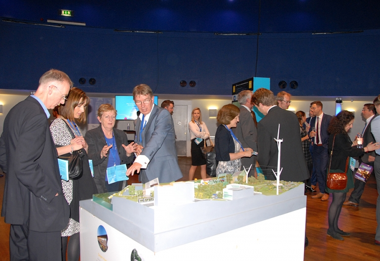 12 - Attendees at the Powershift Summit explore the 3d installations, 18 September 2015.
